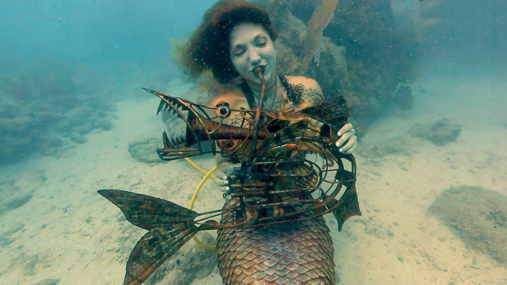 Scuba divers just played 'The Little Mermaid' under the actual sea