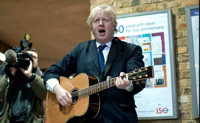 Boris Johnson 'plays' guitar