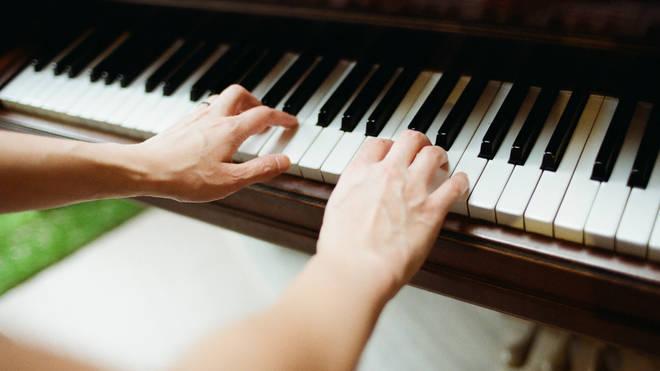 Piano practice stock image