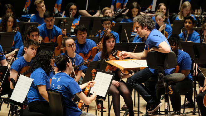 Gustavo Dudamel and young musicians at the Barbican