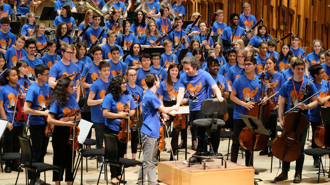 Gustavo Dudamel and young musicians at Tuning into Change