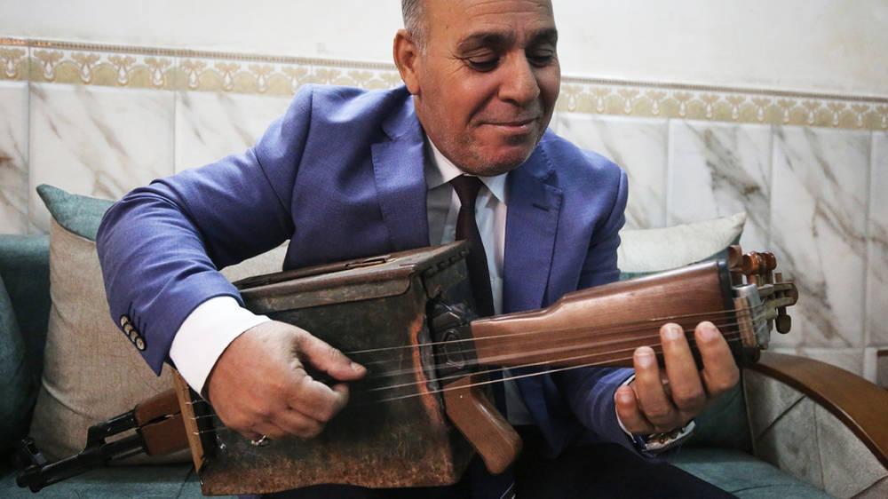 Iraqi school teacher transforms assault rifle into a musical instrument