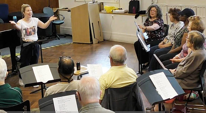 Choir members attend a weekly rehearsal in London