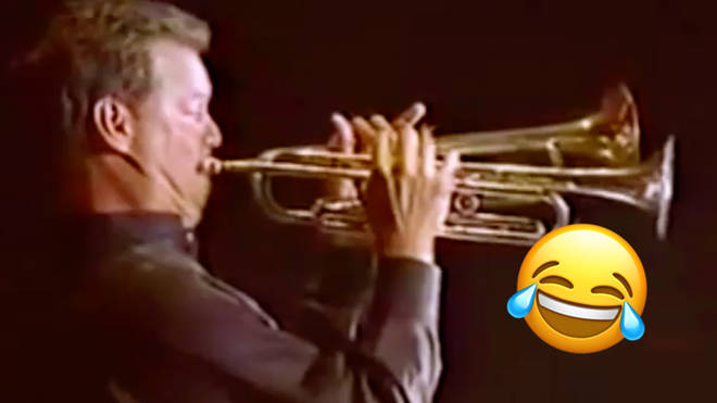 Guy plays two trumpets at the same time