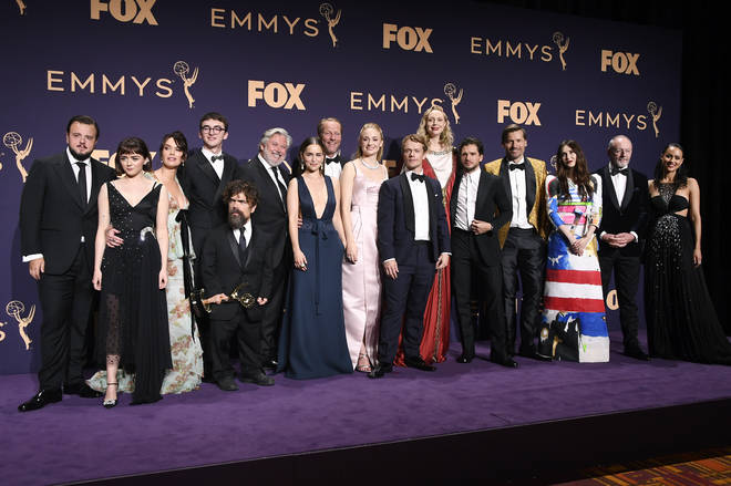 'Game of Thrones' cast and crew pose with awards for Outstanding Drama Series at 71st Emmy Awards.