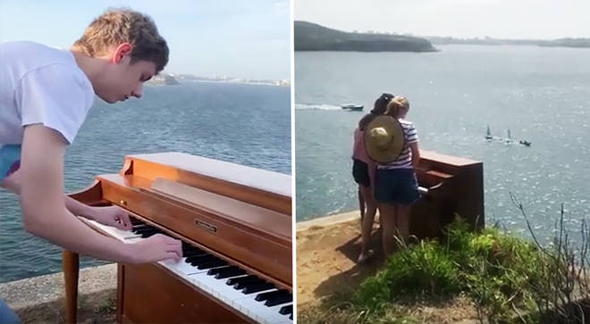 A piano has been abandoned on top of a cliff