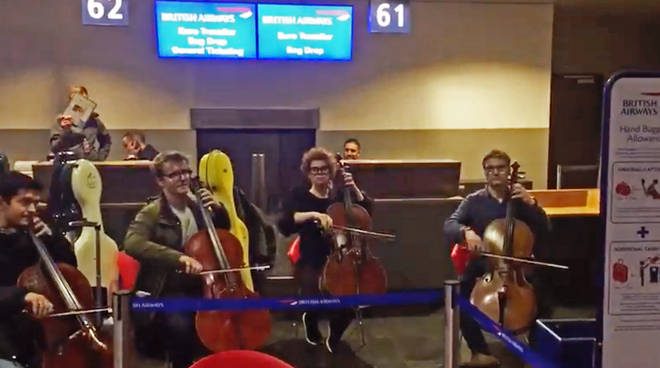 Cellists playing at the British Airway's check-in