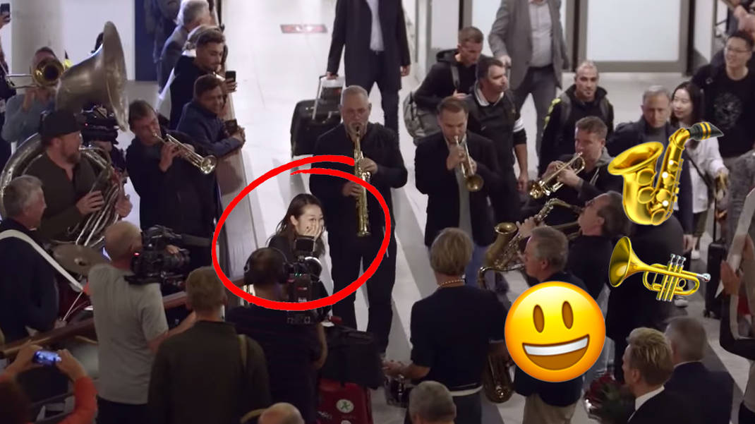 Danish big band joyfully surprises their new Japanese conductor... at the airport