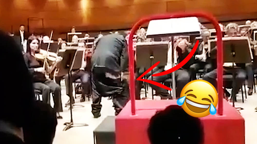 Orchestra plays on as conductor's trousers fall down during performance