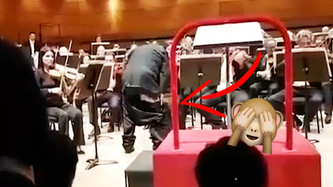 Muhai Tang's trousers fall to his knees during a performance