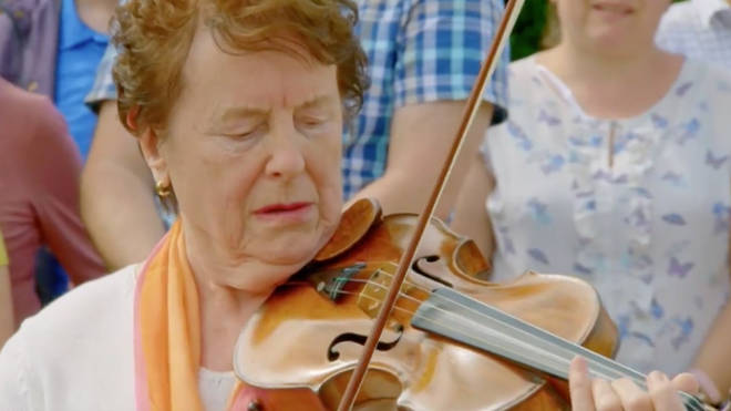 Antiques Roadshow guest playing her violin