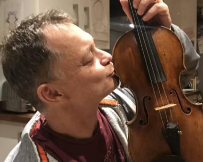 Stephen Morris reunited with his violin