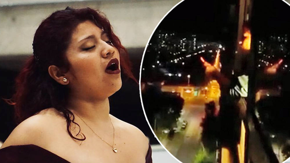 Chilean soprano sings out of her window in powerful defiance of government-imposed curfew