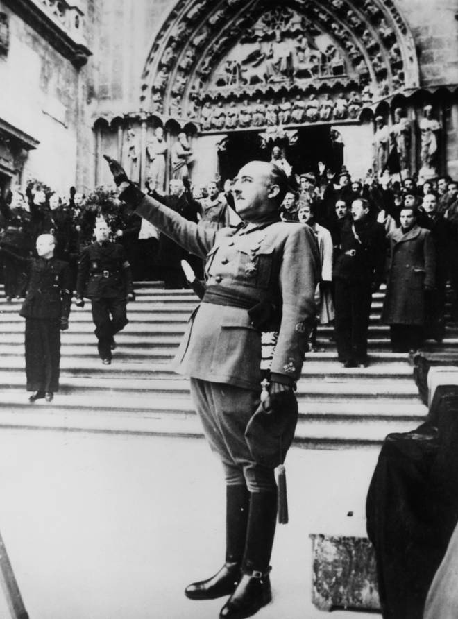General Francisco Franco salutes during the singing of the Nationalist national anthem - 1938